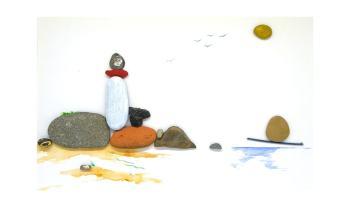 cuadro costero hecho con piedras planas de mar