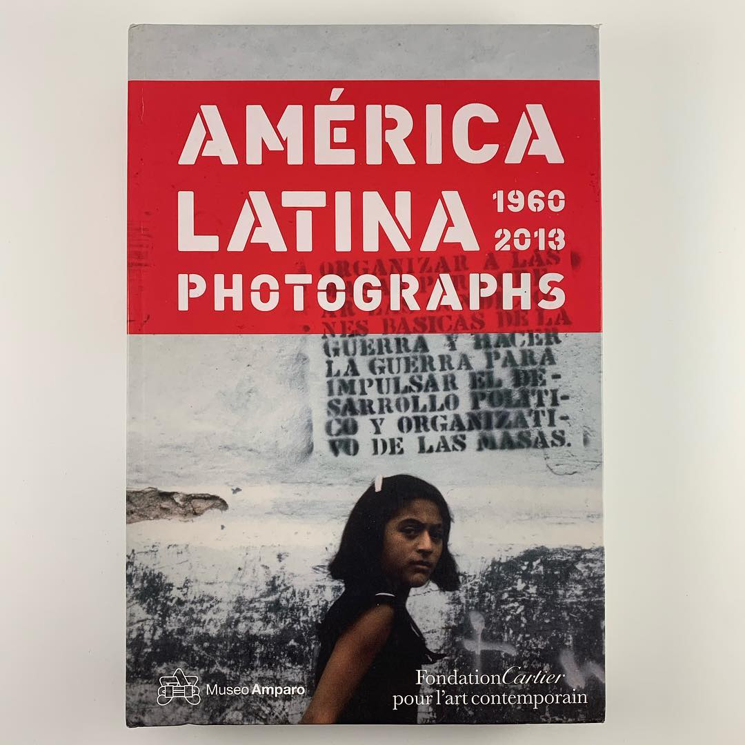 Book cover with a photograph of a person looking straight forward at the viewer in front of a cement wall.