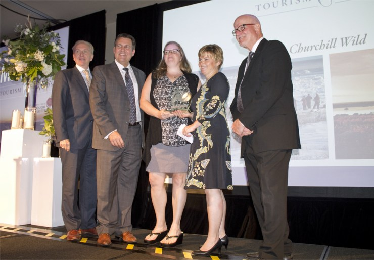 Churchill Wild co-owner Jeanne Reimer and Churchill Wild Finance and Admin Manager Shari Wright shown above accepting the Winnipeg Airports Authority Award of Distinction. L to R: Bob Sparrow, chairman of Travel Manitoba Board of Directors; Hon. Cliff Cullen, Minister of Growth, Enterprise and Trade, PC Party of Manitoba; Shari Wright; Jeanne Reimer; Barry Rempel, President and Chief Executive Officer, Winnipeg Airports Authority.