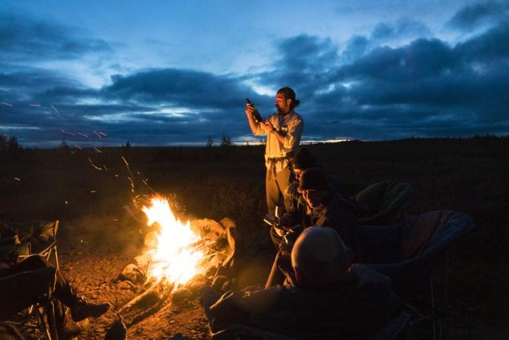 Storytelling around the campfire at Tundra Camp. Jad Davenport photo.