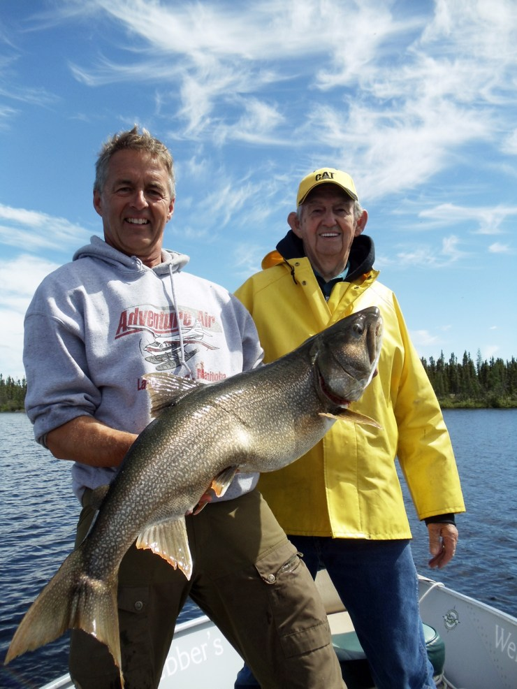 Mike Reimer and Dad Melvin with another trophy laker at North Knife Lake Lodge. Nice catch Dad!