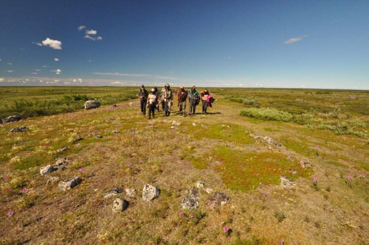 Guests exploring ancient tent rings at Seal River.