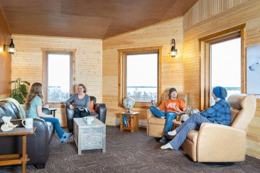 Guests relaxing in lounge at Dymond Lake Ecolodge. Scott Zielke photo. Churchill Wild.