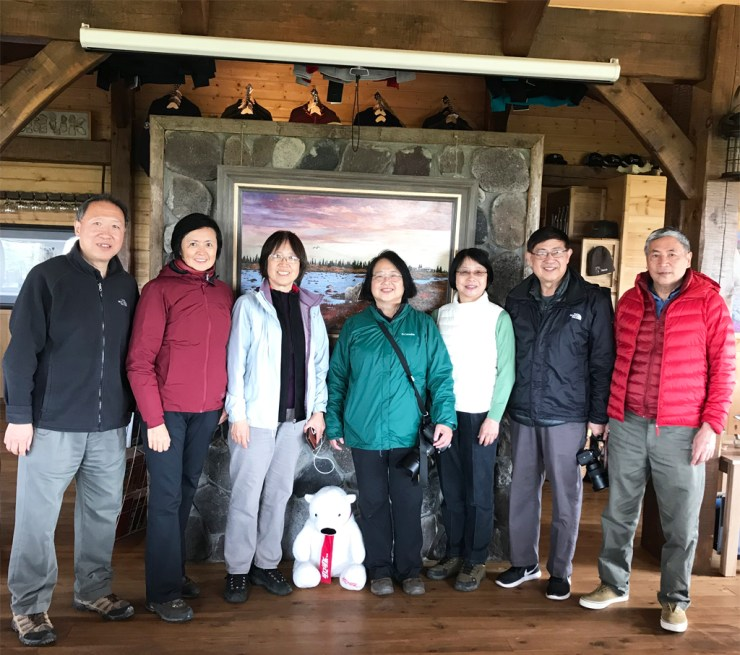 An Xiao (center, green jacket) and her friends at Nanuk Polar Bear Lodge.