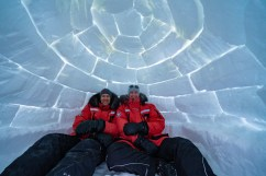 Christoph and Fabienne Jansen in igloo at Nanuk Polar Bear Lodge.
