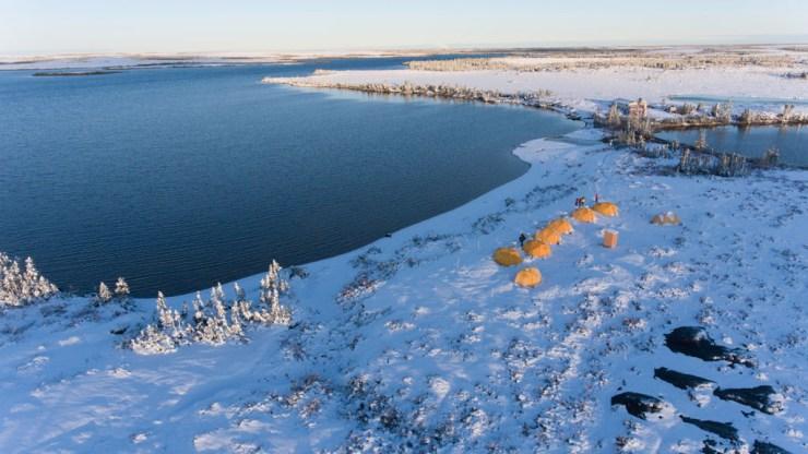 Snow over Tundra Camp at Schmok Lake on Churchill Wild's Arctic Safari. Jad Davenport photo.