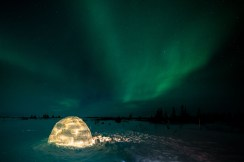 Igloo under northern lights. Nanuk Polar Bear Lodge. Christoph Jansen photo.