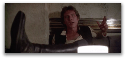 Angle #1: Han Solo seconds before his blaster, hidden from view by his leg, goes off.