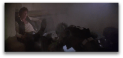 Angle #3: Greedo lies slumped over, while Han Solo sits upright, still holding his blaster on his leg.