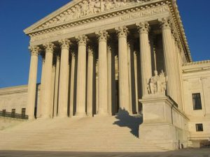 US Supreme Court building, front elevation, steps and porticoby Duncan Lock, used under CCA-SA
