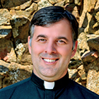 Father Tim, The Rector, is in charge of the Staff