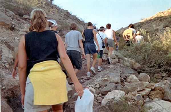 Team climbing a mountain