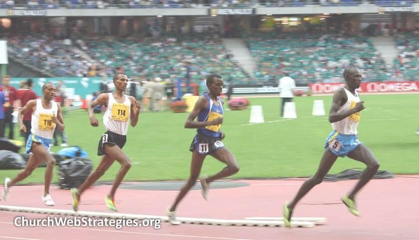 sprinters running around a track