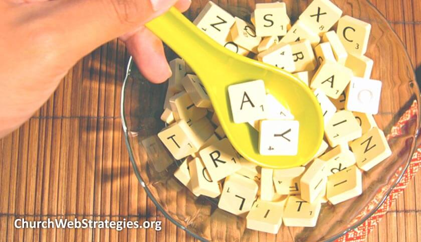 spoon scooping letter tiles out of a bowl