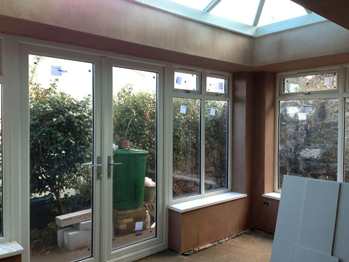 Windows fitted and walls plastered.
