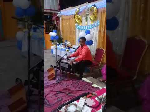 Jairam Dindial singing at a 63rd Birthday party
