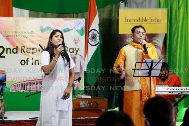Paritosh Kumar Sinha, right, performs a patriotic song, with by Savita Singh, during the ceremony marking the 72nd Republic Day of India