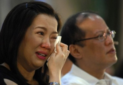 Kris Aquino weeps while her brother Senator Aquino III listens during a memorial service for their late mother former Philippine president Aquino at Manila Cathedral