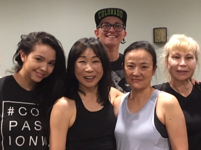 Instructor, Yuko Caruso, and Chuze Fitness members after a yoga class in The Studio