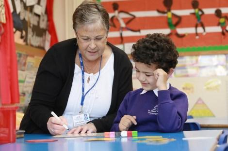 Teacher with primary school pupil