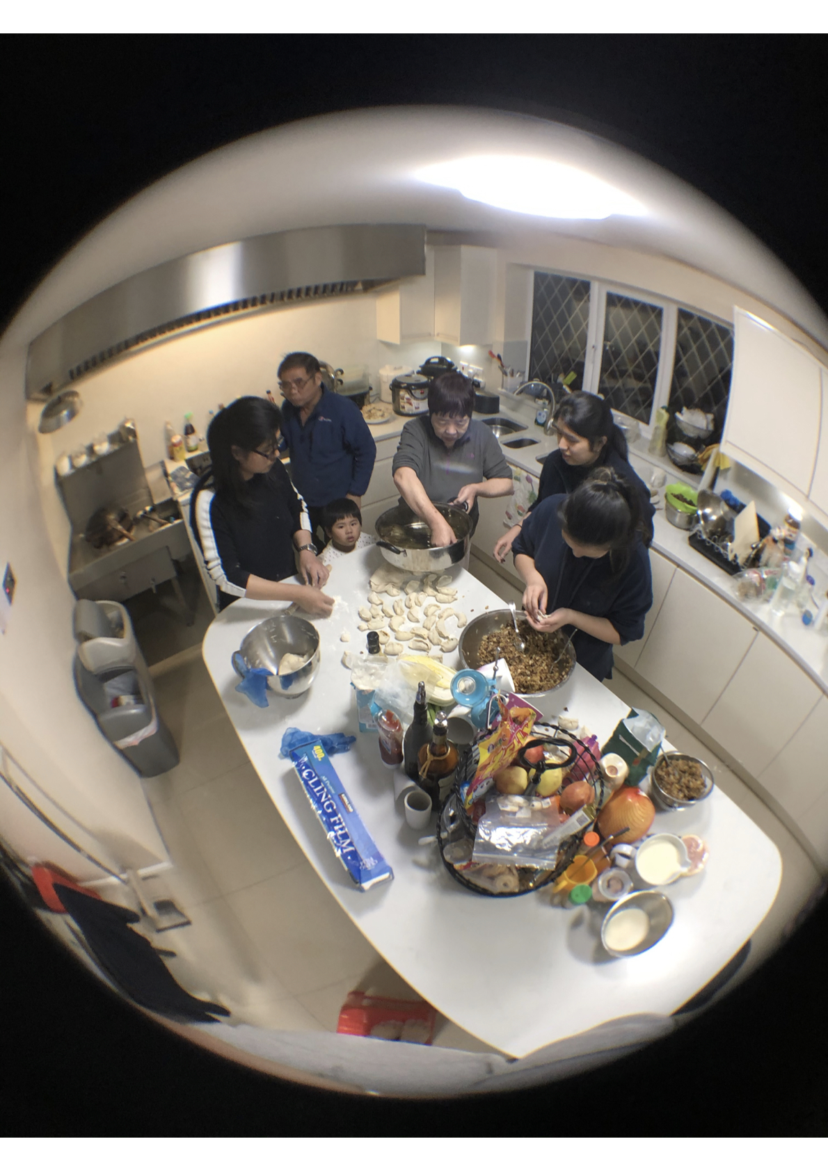 In my photography, I chose to use a fisheye lens on my camera to get a fuller picture of what I was capturing. I depict my experience of the whole family gathered around the island, each person taking on a different role in the dumpling making process. I like the effect the fisheye lens has on the photo as it gives the whole photo a sense of togetherness and 'interconnectivity' meanwhile representing the annual nature of the popular Chinese New Year festival and mid-autumn festival. - Karen Chen
