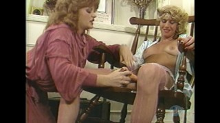 Redhead shows housewife how to dildo