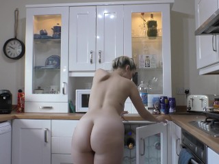 Naughty blonde nude in the kitchen