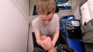 Young saleswoman sucked a buyer in a fitting room