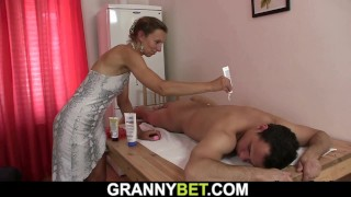 Hairy mature masseuse takes it from behind