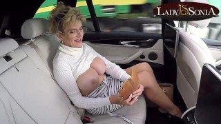 Big boob mature Lady Sonia letsher tits loose in the car