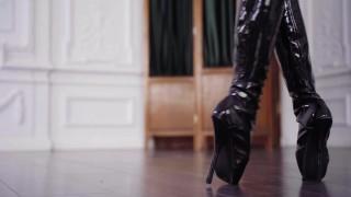 Brunette dancing in ballet boots