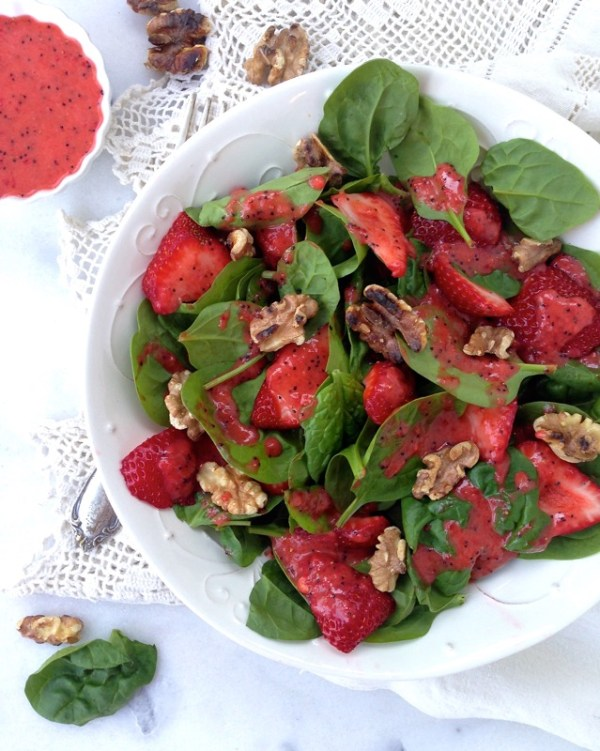 White Bowl of Strawberry Spinach Salad with Walnuts on a Crochet Kitchen Towel