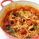 Red Bowl of Spaghetti in Puttanesca Sauce