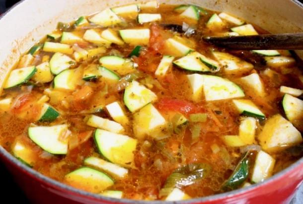 Cooking Italian vegetable soup with zucchini and farro