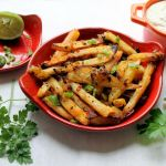 Baked batata harra fries with eggplant dip