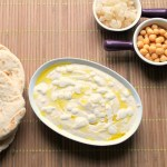Creamy hummus with lemon garlic sauce