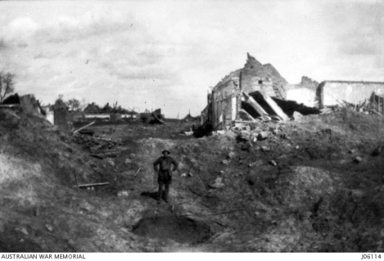 AWM Photo J06114 THE CROSSROADS AT BEAUMETZ, IN FRANCE WHERE MINES MADE HOLES 20 YARDS WIDE AND 6 YARDS DEEP. TAKEN ON 1917.04.05. (DONATED BY MR. T.J. RICHARDS, M.C.)