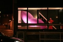 LOVE TRIANGLE at White Night, Phoenix Gallery, Brighton [installation view from street]. CiCi Blumstein 2008.