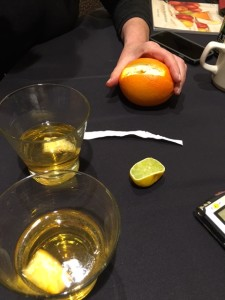 A slice of orange peal is squeezed into the Stone Fence cider cocktail
