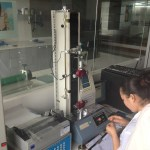 Quality Control Lab - testing adhesive tension