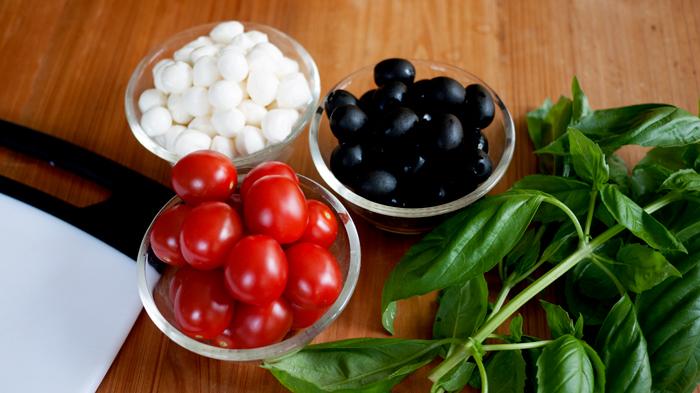 Ingredients mozzarella tomatoes olives basil