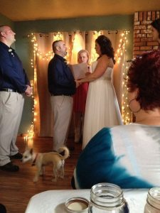 Nick and Melissa saying their vows