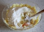 when it cooles a nit, add in the egg and flour, knead