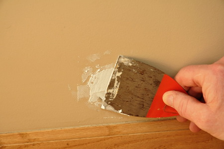 spackle patch a hole in a wall