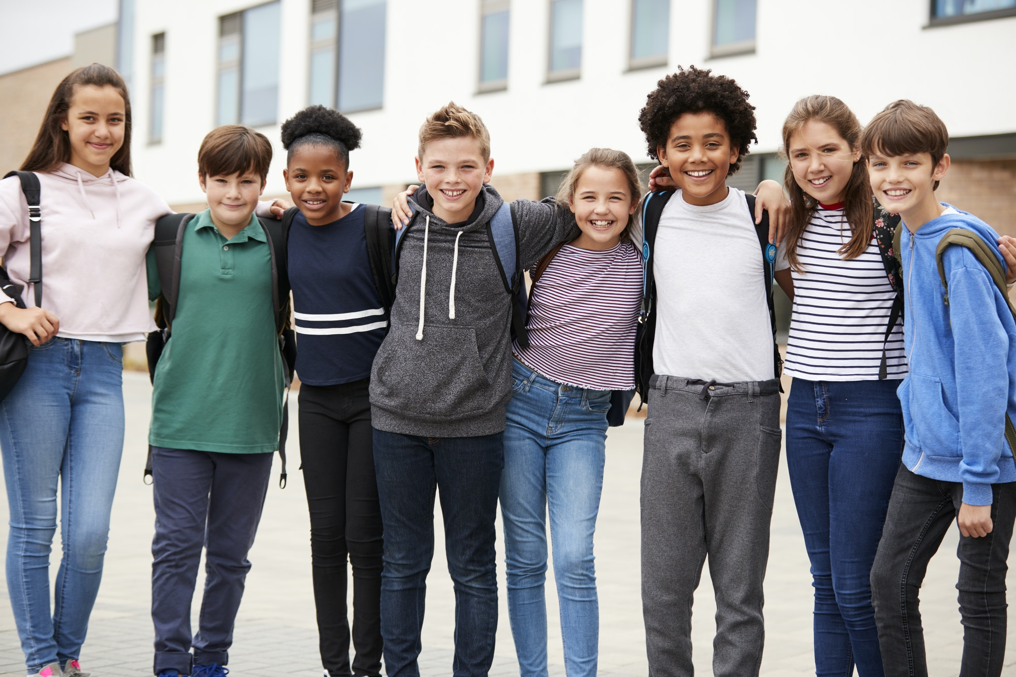 Portrait Of High School Student Group Standing Outside School Buildings