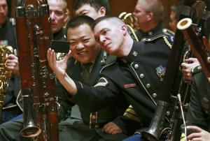 Musicians from the military bands of China's People's Liberation Army and the U.S. Army take photos during a rehearsal for their joint concert in Beijing in this file photo
