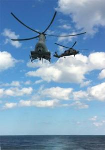 Manned (SH-60B) and unmanned (MQ-8B) helicopters working together on USS Halyburton (FFG 40)
