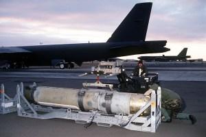 Airmen prepare to load a Mark 60 CAPTOR (encapsulated torpedo) anti-submarine mine onto a B-52G Stratofortress. US Navy