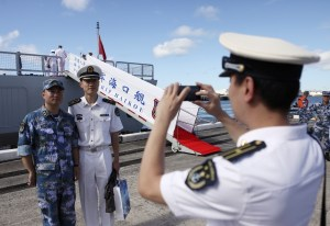 Chinese sailors take a picture together in front of guided missile destroyer Haikou (171)