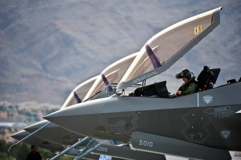 U.S. Air Force Capt. Brad Matherne, a pilot with the 422nd Test and Evaluation Squadron, conducts preflight checks inside an F-35A Lightning II aircraft before its first operational training mission April 4, 2013, at Nellis AFB, NV.